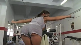 busty brunette having a sex workout in the gym