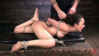 Tied up hooker Roxanne Rae gets her pussy and anus punished
