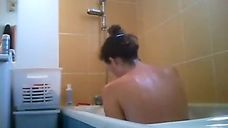 Amateur babe takes a bath naked