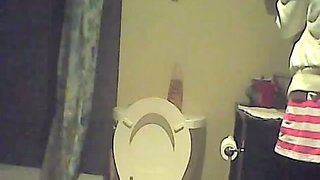 Hidden piss cam in the home toilet shows peeing sister