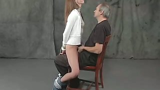 Obedient brunette called JULIA sits on dude's laps and gets hands tied