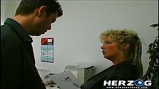 Ugly huge breasted office bitch gets nailed right on the table