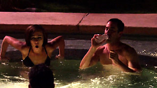 Couples surround each other at hot tub