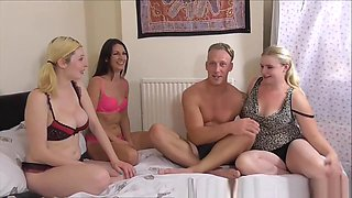 Nasty British Whores Foursome Fucking With Handsome Stud