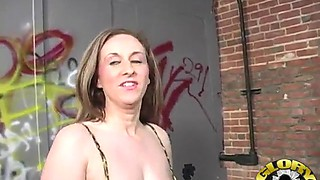 Big titty cowgirl in fishnet stockings giving a stimulating blowjob