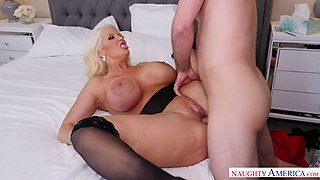 Posh milf with fake boobs Alura Jenson is tacking care of a sick young dude